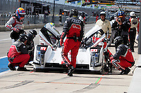 Lucas Di Grassi / Loic Duval / Tom Kristensen of Audi Sport Team Joest (1) LMP1 - H Audi R18 e-tron quattro in the pit road during FIA World Endurance Challenge, Thursday, September 18, 2014 in Austin, Tex. (Gary Faulkenberry/TFV Media via AP Images)