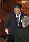 December 24, 2014, Tokyo, Japan - Prime Minister Shinzo Abe casts his ballot in a parliamentary process to elect Japan's new leader during a special Diet session convened in Tokyo on Wednesday, December 24, 2014. Abe was re-elected as prime minister and set to form a new Cabinet. (Photo by Natsuki Sakai/AFLO)