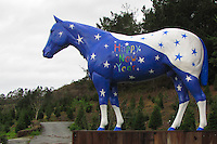 """The horse statue at Lemo's Farm in Half Moon Bay, California, greets passerby with a colorful """"Happy New Year"""" on New Year's Day, 2011."""