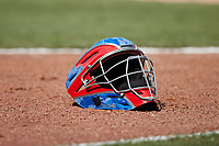 The hockey-style catcher's mask of David García (not pictured) lies on the ground during the game against the Winston-Salem Dash at Truist Stadium on July 10, 2021 in Winston-Salem, North Carolina. (Brian Westerholt/Four Seam Images)