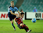 SYDNEY - APRIL 05:  Kim Jinyoung of Pohang Steelers is challenged by Andrew Hoole of Sydney FC during the AFC Champions League group H match between Sydney FC and Pohang Steelers on 05 April 2016 held at Sydney Football Stadium in Sydney, Australia. Photo by Mark Metcalfe / Power Sport Images  (Photo by Power Sport Images/Photo by Mark Metcalfe  / Power Sport Images) *** Local Caption *** Kim Jinyoung;Andrew Hoole