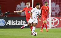 TORONTO, ON - OCTOBER 15: Weston McKennie #8 of the United States turns with the ball during a game between Canada and USMNT at BMO Field on October 15, 2019 in Toronto, Canada.