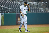 Augusta GreenJackets manager Jolbert Cabrera (8) goes through his signs as he coaches third base during the game against the Greensboro Grasshoppers at First National Bank Field on April 10, 2018 in Greensboro, North Carolina.  The GreenJackets defeated the Grasshoppers 5-0.  (Brian Westerholt/Four Seam Images)
