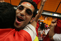 Tunisian National Soccer Team hug and cheer  at the Marienplatz City Ceter subway station in Munich, Germany on Wednesday, June 14th, 2006. The fans were on their way to the Bayern-Munich arena to watch Tunisia play their FIFA World Cup first round match against Saudi Arabia .  The two teams tied at 2-2.