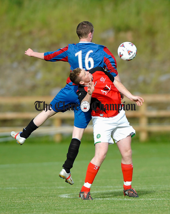 Newmarket's Gary Leahy in action against his Kildysart opponent during their Youths final at Cassidy Park. Photograph by John Kelly.
