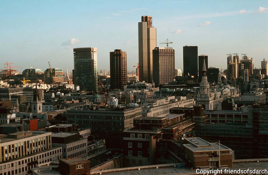 London:  3. Panoramic view from St. Paul's.  NE and East, roof of Bank of England; Offices, foreground; Steeple of St. Lawrence Jewry, left; St. Mary Le Bow, right; National Westminster Tower, center, and Lloyd's, right. Photo '90.