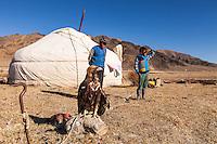 Asia Mongolia, Altai mountain,Saikhsai, children of he hunter Saelikhan around their ger with the Golden Eagle