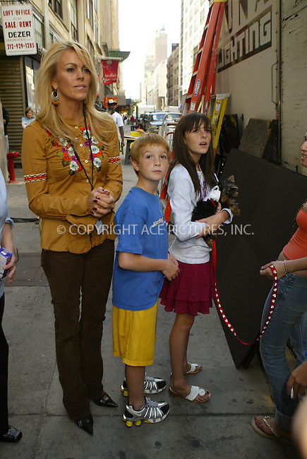 WWW.ACEPIXS.COM . . . . . ....NEW YORK, SEPTEMBER 28, 2005....Dina Lohan, Dakota Lohan and Aliana Lohan on the set of Lindsay Lohan's new music video with a puppy that has a piece of paper attached to it that says 'I Love Lindsay.' ....Please byline: JENNIFER L GONZELES-ACE PICTURES.. . . . . . ..Ace Pictures, Inc:  ..Craig Ashby (212) 243-8787..e-mail: picturedesk@acepixs.com..web: http://www.acepixs.com
