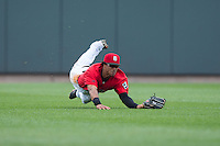 Birmingham Barons center fielder Jacob May (20) makes a diving catch against the Tennessee Smokies at Regions Field on May 4, 2015 in Birmingham, Alabama.  The Barons defeated the Smokies 4-3 in 13 innings. (Brian Westerholt/Four Seam Images)