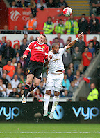 Pictured L-R: Wayne Rooney of Swansea heads the ball over Ashley Williams of Swansea Sunday 30 August 2015<br /> Re: Premier League, Swansea v Manchester United at the Liberty Stadium, Swansea, UK