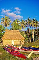 Sea kayaks by bure and palm trees, Yasawa Islands, Fiji