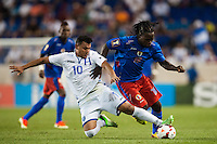 Honduras forward Mario Martinez (10) goes for a tackle on Haiti forward Leonel Saint Preux (18). Honduras defeated Haiti 2-0 during a CONCACAF Gold Cup group B match at Red Bull Arena in Harrison, NJ, on July 8, 2013.