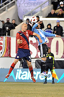 Michael Bradley (4) of the United States and Ezequiel Lavezzi (22) of Argentina go up for a header. The United States (USA) and Argentina (ARG) played to a 1-1 tie during an international friendly at the New Meadowlands Stadium in East Rutherford, NJ, on March 26, 2011.