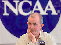 John McDonnell, head track and field coach at Arkansas, listens to a question during a new conference at Duke University, in Durham, N.C., Tuesday, May 30, 2000, concerning the NCAA Track and Field Championships that start Wednesday. McDonnell and Arkansas will be going for their ninth straight championship.(AP Photo/Bob Jordan)