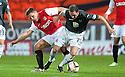Partick's Mark Kerr and Dundee Utd's John Rankin challenge for the ball.