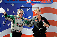 Sept. 6, 2010; Clermont, IN, USA; NHRA funny car driver John Force (left) and Bob Bode during driver introductions prior to the U.S. Nationals at O'Reilly Raceway Park at Indianapolis. Mandatory Credit: Mark J. Rebilas-