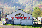 An old barn at the foot of the Smoky Mountains in Tennessee is converted into an antique shop and live country music stage.