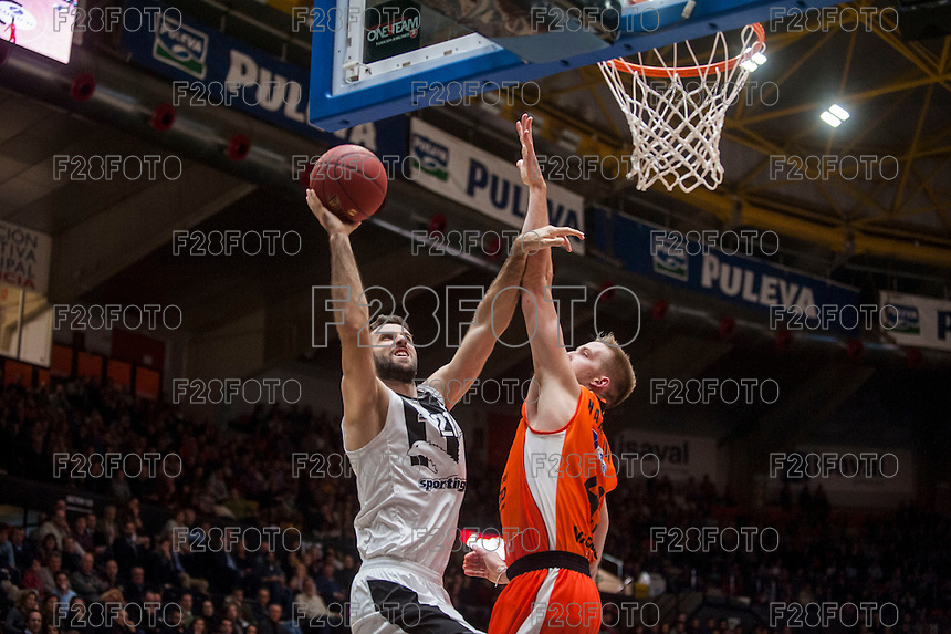 VALENCIA, SPAIN - JANUARY 6: Nikola Markovic and Justin Hamilton during EUROCUP match between Valencia Basket and PAOK Thessaloniki at Fonteta Stadium on January 6, 2015 in Valencia, Spain
