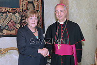 mons. Dominique Mamberti, talks with German Chancellor Angela Merkel during a private audience at the Vatican on May 18, 2013.