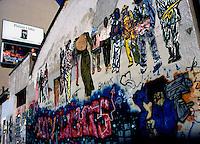 Milano, 1989.Veduta esterna del CS Leoncavallo. I muri sono coperti di graffiti e scritte di carattere politico contro lo sgombero da parte delle forze di polizia avvenuto nell'agosto del 1989..Foto Livio Senigalliesi