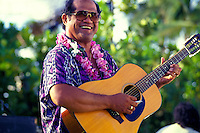 A musician performing at the Hawaiian slack key guitar festival