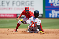 Clearwater Threshers second baseman Jose Gomez (3) tags Kevin Josephina (20) out on a stolen base attempt during a Florida State League game against the Florida Fire Frogs on April 24, 2019 at Spectrum Field in Clearwater, Florida.  Clearwater defeated Florida 13-1.  (Mike Janes/Four Seam Images)