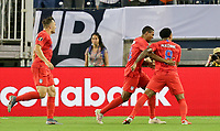 NASHVILLE, TENN - JULY 03: Weston McKennie #8 scores a goal and celebrates with his USMNT during a 2019 CONCACAF Gold Cup Semifinal match between the United States and Jamaica at Nissan Stadium on July 03, 2019 in Nashville, Tennessee.