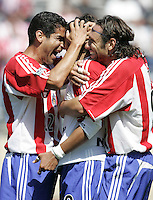 9 April 2005:  Chivas USA's Hector Cuadros celebrates Arturo Torres and Thiago Martins after scoring a goal in 73 minute during the second half of the game against SJ Earthquakes.   San Jose Earthquakes tied Chivas USA, 3-3.   Credit: Michael Pimentel / ISI