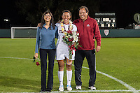 STANFORD, CA - October 21, 2012: Marjani Hing-Glover with her family during the Senior Day celebration after the Stanford vs Washington women's soccer match in Stanford, California.  Stanford won 3-0.