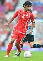 July 26, 2012..UAE's Hamdan Al Kamali (8). UAE vs Uruguay Football match during 2012 Olympic Games at Old Trafford in Manchester, England. Uruguay defeat United Arab Emirates 2-1...