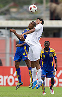 Joshua Nieto (19) of Honduras goes up for a header with Nathaniel Maynard (4) of Barbados  during the group stage of the CONCACAF Men's Under 17 Championship at Catherine Hall Stadium in Montego Bay, Jamaica. Honduras defeated Barbados, 2-1.