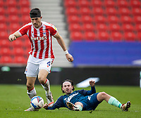 20th March 2021; Bet365 Stadium, Stoke, Staffordshire, England; English Football League Championship Football, Stoke City versus Derby County; Patrick Roberts of Derby County misses a tackle on Danny Batth of Stoke City