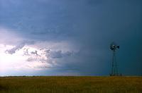 Weather vane on landscape<br />