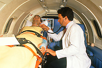 Emergency medical aircraft transport with accompanying doctor