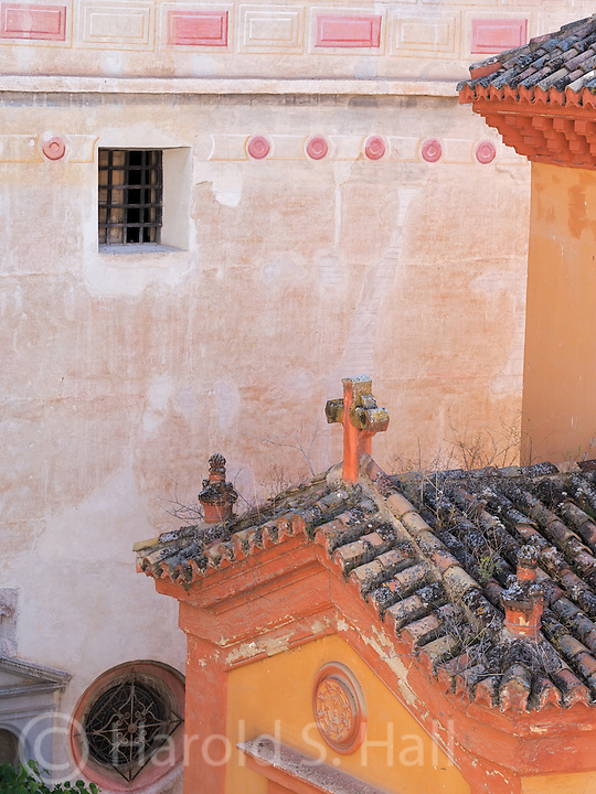Weeds are growing on this old church roof in Granada, Spain.  This photo was taken from the balcony of our rented apartment.  We had wonderful views of the Alhambra as well as village scenes such as this one.