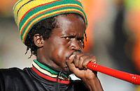 A Cameroon fan blows a vuvuzela, which may possibly be banned from the tournament for excessive noise