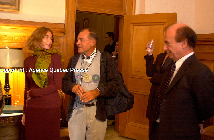 August 30, 2001, Montreal, Quebec, Canada<br /> <br /> Andre Lafond , Montreal's Cinema commisionner  (R) look at Emmanuelle Beart (BÈart), French actress and President of the 25th World Film Festival Jury (Festival des Films du Monde )(L) as she arrive with other Jury members at the  Montreal City Hall, for a reception,  August 30 , 2001 in Montreal, CANADA.<br />  <br /> Mandatory Credit: Photo by Pierre Roussel- Images Distribution. (©) Copyright 2001 by Pierre Roussel <br /> ON SPEC<br /> NOTE l Nikon D-1 jpeg opened with Qimage icc profile, saved in Adobe 1998 RGB.