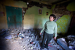 Nely Julia Flores de Serrano in San Marcos stands in her house damaged after a 7.4 earthquake struck Guatemala.