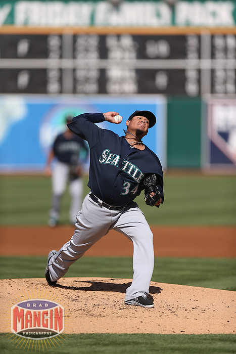 OAKLAND, CA - JUNE 15:  Felix Hernandez #34 of the Seattle Mariners pitches against the Oakland Athletics during the game at O.co Coliseum on Saturday June 15, 2013 in Oakland, California. Photo by Brad Mangin