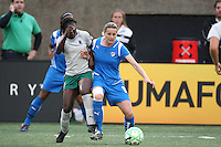 Kelly Smith tries to hold on to the ball while getting pressure from the Athletica defense. Saint Louis Athletica defeated the Boston Breakers 1-0 in Cambridge, Massachusetts on June 14, 2009.