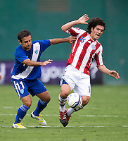 Cristian Riveros (16) of Paraguay fights for the ball with Jose Contreras (11) of Guatemala during the game at RFK Stadium in Washington, DC.  Guatemala tied Paraguay, 3-3.