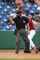 Home plate umpire Joe George makes a call during a game between the Tampa Yankees and Clearwater Threshers on April 21, 2015 at Bright House Field in Clearwater, Florida.  Clearwater defeated Tampa 3-0.  (Mike Janes/Four Seam Images)
