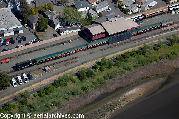 aerial photograph of the Napa Valley Wine Train, City of Napa, Napa County, California at its current southern terminus at the maintenance yard of the California Nothern Railroad and Union Pacific at the eastern shore of the Napa River