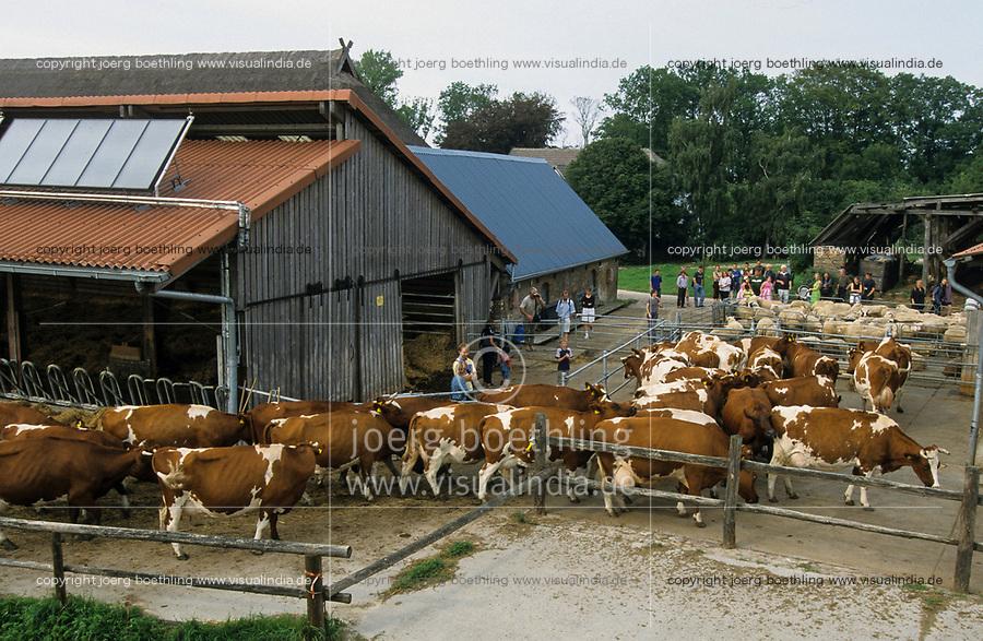 GERMANY, open house on organic farm, milk cow stable / DEUTSCHLAND, Biofarm Hof Bisdamitz auf Rügen, Tag der offenen Tuer