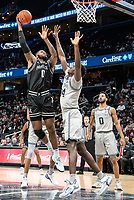 WASHINGTON, DC - FEBRUARY 19: Nate Watson #0 of Providence lobs in a shot overQudus Wahab #34 of Georgetown during a game between Providence and Georgetown at Capital One Arena on February 19, 2020 in Washington, DC.