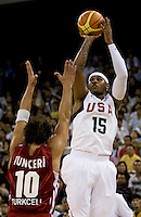 US Men's Basketball team forward (15) Carmelo Anthony shoots over Turkish guard (1) Kerem Tunceri at the Cotai Arena in the Venetian Macau Hotel & Resort.  The US defeated Turkey, 114-82.