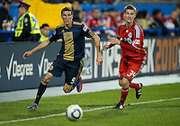 15 April 2010: Toronto FC defender Raivis Hscanovics #34 and Philadelphia Union forward Sebastien Le Toux #9 in action during a game between the Philadelphia Union and Toronto FC at BMO Field in Toronto..Toronto FC won 2-1..Photo by Nick Turchiaro/isiphotos.com........12 September 2009:Toronto FC forward Chad Barrett # 19 takes the ball up field during MLS action at BMO Field Toronto in a game between Colorado Rapids and Toronto FC. .Photo by Nick Turchiaro/isiphotos.comApril 12 2010: Chicago White Sox second baseman Gordon Beckham #15 and Chicago White Sox shortstop Omar Vizquel #11celebrate the win during the Toronto Blue Jays home opener between the Chicago White Sox and the Toronto Blue Jays at Rogers Centre in Toronto, Ontario..The White Sox won 8-7 in 11 innings.........11 April 2009:Toronto FC forward Chad Barrett # 19 takes the ball up field during MLS action at BMO Field Toronto, in a game between FC Dallas and Toronto FC. .Toronto FC won 2-1.