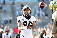 CHAPEL HILL, NC - NOVEMBER 14: Ivan Mora #96 of Wake Forest warms up on the sideline during a game between Wake Forest and North Carolina at Kenan Memorial Stadium on November 14, 2020 in Chapel Hill, North Carolina.