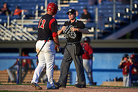 Batavia Muckdogs third baseman Ryan Cranmer (12) talks with umpire Tyler Jones during the second game of a doubleheader against the Mahoning Valley Scrappers and Batavia Muckdogs on July 2, 2015 at Dwyer Stadium in Batavia, New York.  Mahoning Valley defeated Batavia 3-0.  (Mike Janes/Four Seam Images)