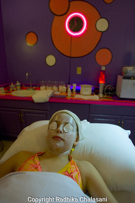 SAN ANTONIO, TEXAS-MARCH 25: Madison (10) relaxes during her first facial at Spaaht, a spa for those under 17, at the Hyatt Regency Hill Country Resort, March 25, 2005 in San Antonio. The spa is one of a growing number across the U.S. catering to the teen and pre-teen age group and offers massages (40 USD), facials (40 USD), glitter manicures (30 USD) and pedicures (35 USD) and hair braiding (3.50 USD/braid).  (Photo by Radhika Chalasani)